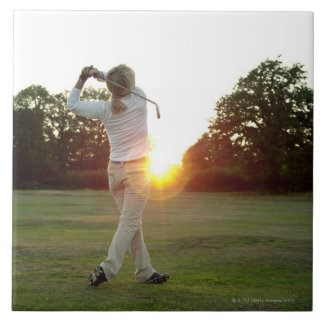 Sunset golf swing tile