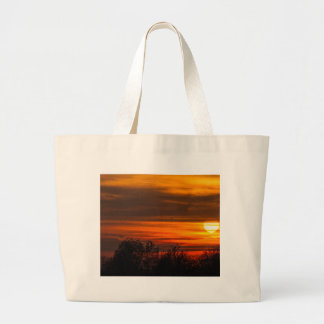 sunset in winter large tote bag