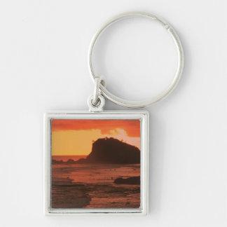 Sunset on a rocky coast key chain