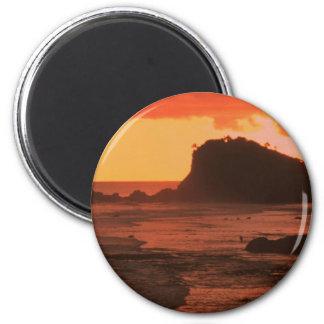 Sunset on a rocky coast fridge magnets