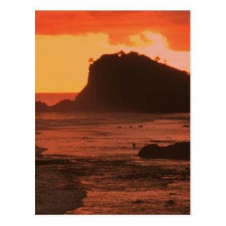 Sunset on a rocky coast postcard