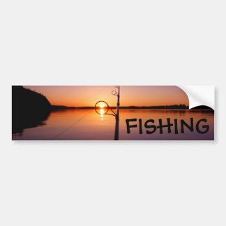Sunset on a summer lake seen through a fishing rod bumper sticker