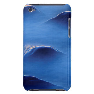 Sunset on rocks protruding through foamy water iPod touch case