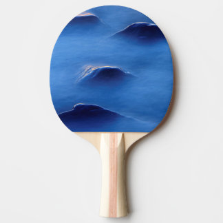 Sunset on rocks protruding through foamy water ping pong paddle
