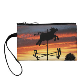 Sunset Over a Cow Weather Vane Change Purses