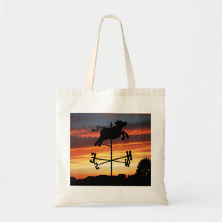 Sunset Over a Cow Weather Vane Tote Bags