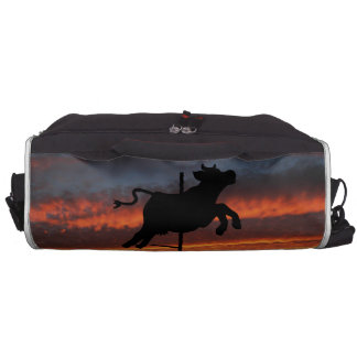 Sunset Over a Cow Weather Vane Bags For Laptop