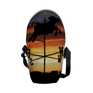 Sunset Over a Cow Weather Vane Courier Bags