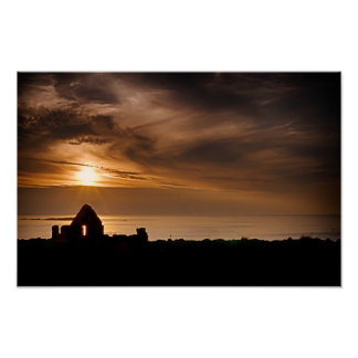 Sunset over Dunluce Castle in Northern Ireland Poster