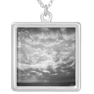 Sunset over ocean silver plated necklace