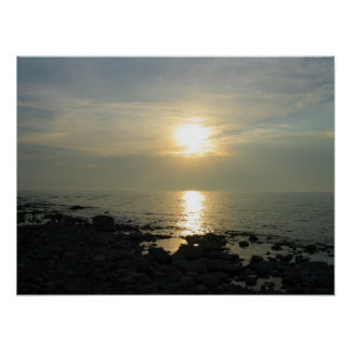 Sunset over Rocky Coast Poster