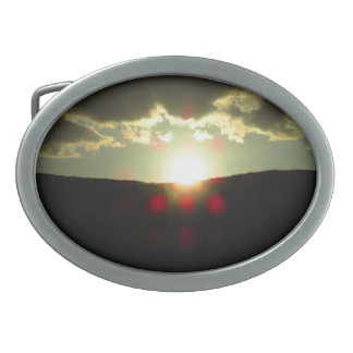 Sunset over the hill belt buckles
