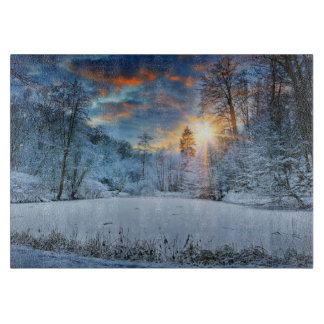 Sunset Over Winter Forest Lake Cutting Board