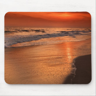 Sunset reflections off clouds and ocean shore mouse pad