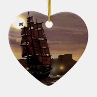 Sunset sailing boat viewed through spyglass. ceramic heart decoration