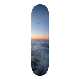 Sunset sky view flying above the clouds Skateboard