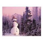 Sunset Snowman in the Winter Mountains Post Card