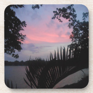 Sunset through the palm trees beverage coasters