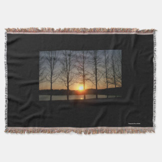 Sunset through the trees throw blanket