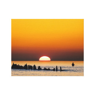 Sunset with angler on shore of the Baltic Sea Canvas Print
