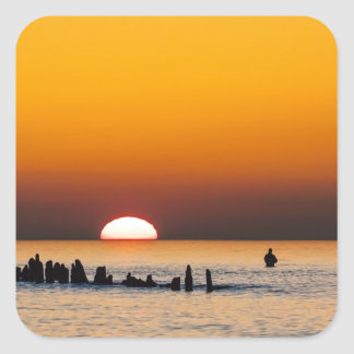 Sunset with angler on shore of the Baltic Sea Square Stickers