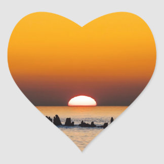 Sunset with angler on shore of the Baltic Sea Heart Stickers