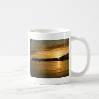 Sunset with yacht coffee mug