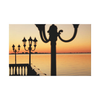Sunsetting behind old street lamps canvas print