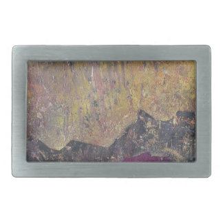 Sunshine over craggy landscape belt buckles