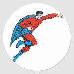 superhero caped male running flying punching classic round sticker