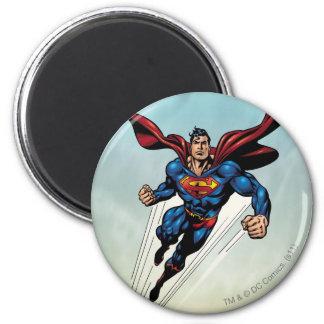 Superman leaps upward 6 cm round magnet