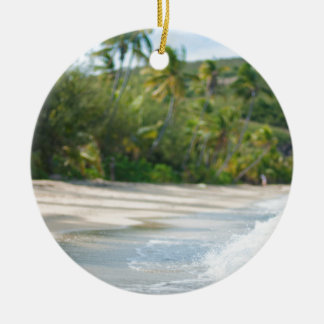 Surf breaking on a sandy beach christmas ornament