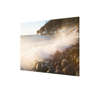 Surf washes over the cobblestones in Monument Gallery Wrap Canvas