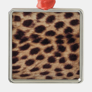 Surface of spotted feline christmas ornament