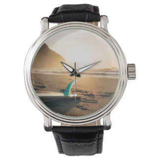 Surfboard watch. Sunset, beach, sea Watch
