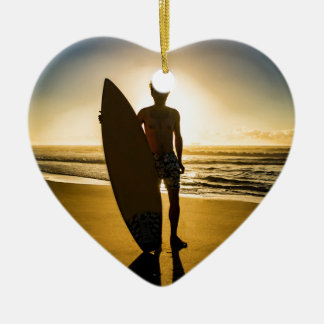 Surfer silhouette during sunrise christmas ornament