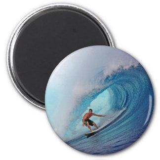Surfer surfing a huge wave. 6 cm round magnet