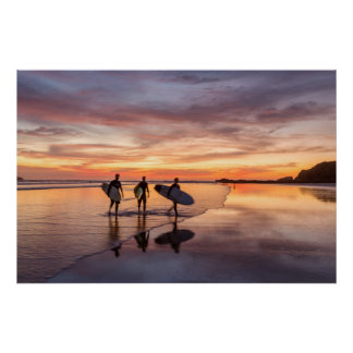 Surfers At Sunset Walking On Beach, Costa Rica Poster