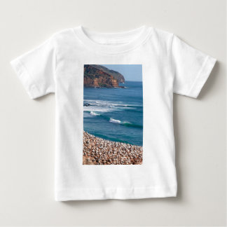 Surfing at Muriwai Beach in front of Gannet colony Baby T-Shirt