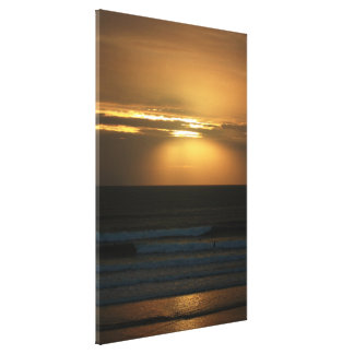 Surfing at Sunset Canvas Print