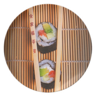 Sushi and wooden chopsticks dinner plate