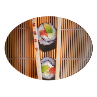 Sushi and wooden chopsticks porcelain serving platter