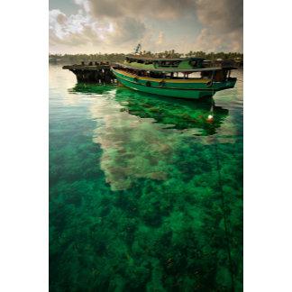 A green boat in an archipelago