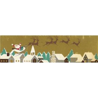 santa and reindeers over rooftops