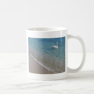 Swan in crystal clear shallow sea water basic white mug
