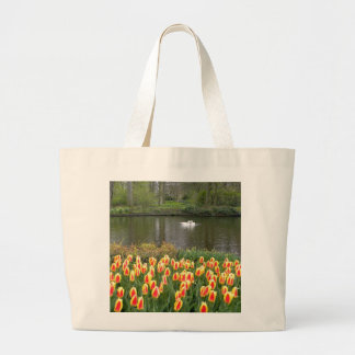 Swans by a lake with tulips Keukenhof Tote Bags
