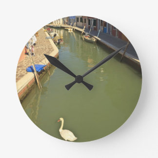 Swans in canal, Burano Island, Venice, Italy Round Clock