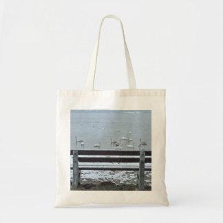 Swans, lake and a bench - bag
