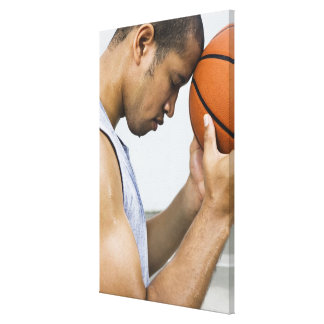 sweating man leaning forehead on basketball canvas print