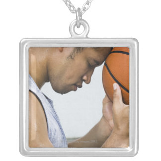 sweating man leaning forehead on basketball silver plated necklace